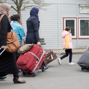 epa05243586 Syrian refugees arriving at the border entrance camp Friedland near Goettingen, Germany, 04 April 2016. A group of 16 Syrian refugees arrived on a scheduled flight from Turkey under the agreement between the European Union and Turkey, which received earlier the first batch of migrants from Greece. Meanwhile, Greece started on 04 April sending so-called 'irregular migrants' back to Turkey in a one-for-one exchange for Syrian refugees in Turkish camps.  EPA/SWEN PFOERTNER