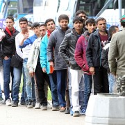 epa05310284 Migrants waiting in line for humanitarian aid on their way to European Union countries, passing through Belgrade, Serbia, 16 May 2016. Frontex the European border agency, said on 13 May 2016 that the number of migrants arriving on the Greek islands in April plunged by 90 per cent compared to the previous month, reaching fewer than 2700. The drop is a result of several factors, including The EU-Turkey agreement and stricter border policies applied by the former Yugoslav Republic of Macedonia at its border with Greece.  EPA/KOCA SULEJMANOVIC