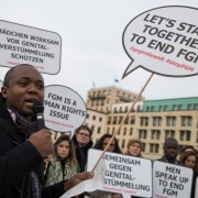 epa06345300 A participant of the rally against female genital mutilation speaks at the Brandenburg Gate in Berlin, Germany, 23 November 2017. A group of activists 'TERRE DES FEMMES' organized the event ahead of the International Day for the Elimination of Violence against Women on 25 November which was designated by the United Nations.  EPA-EFE/H. JEON